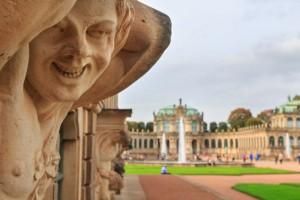 Closeup naked satyr smiling statue crop with fountain and garden